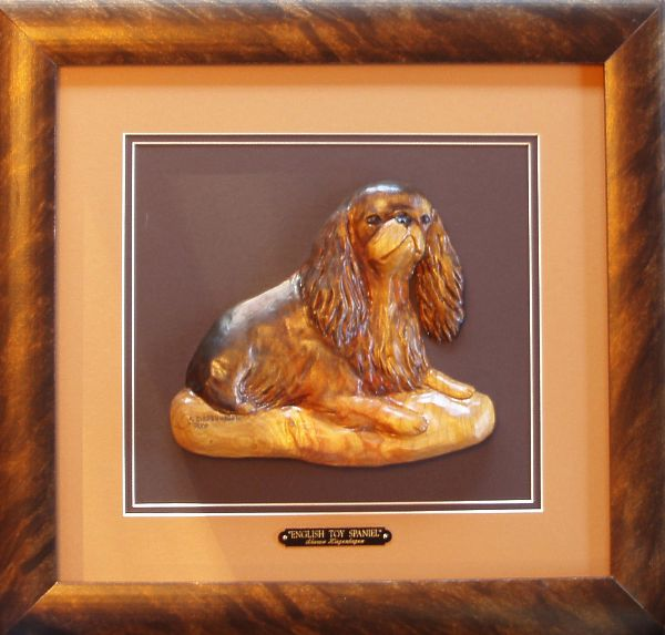Spaniel wildlife sculptures and bas relief or low