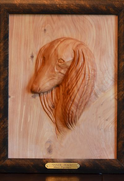 Saliki dog wildlife sculptures and bas relief or low relief wood