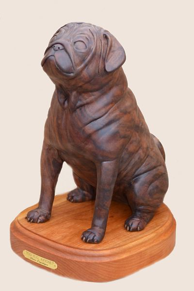 Pug dog wildlife sculptures and woodcarvings