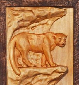 Wildlife sculptures and bas relief or low relief wood carvings